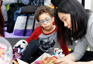 """New Alternatives For Children ( nackidscan.org ) conducts the annual Book Fair in the 26th Street office. Joining NAC are volunters from Kohl's and Capital One Bank. Also, reading from his book """"A Stone Of Hope"""" is Jim St. Germain. New York City April"""